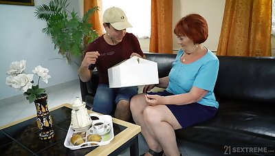 Dirty mature redhead Marsha gives BJ and gets pounded doggy style