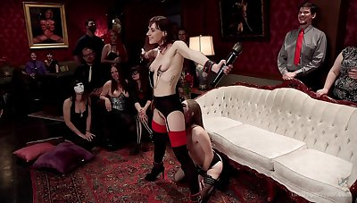 Alice March and Audrey Holiday are among the subs at a BDSM stripe