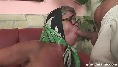 Ugly old woman shows her beautiful big tits and fucks interesting lad