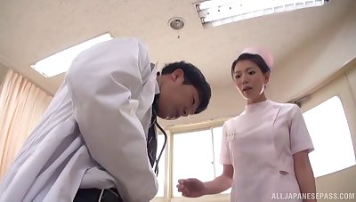Horny Japanese nurse gives head and rides his detect on the bed
