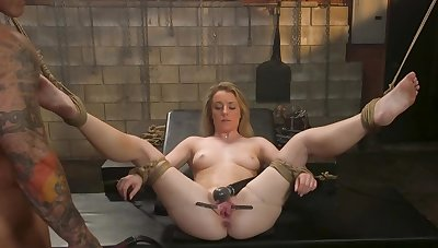 Chubby blonde is enduring some pussy torture in this sexual relations dungeon